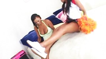Hot lesbian ebony sorority sisters have some fun with a strap-on