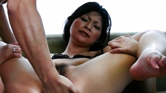 Ryo Sasaki receives pleasure from a huge dildo