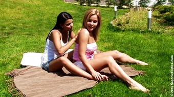 Two horny bombshells playing lesbian games in the garden