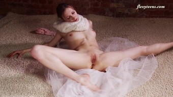Hot and skinny ballerina Ksyuha Zavituha strips and spreads her legs
